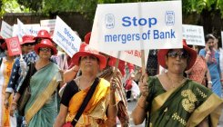 Bank unions call for strike against merger