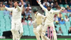 Bad light stops play as Aussies follow on