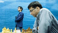 Anand draws with Rapport to stay in joint lead
