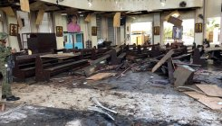 27 dead as bombs target cathedral in Philippines
