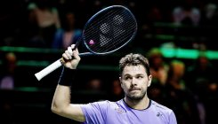 Wawrinka through as Paire switches off