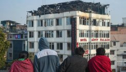Man says suspects sister among Delhi hotel fire victims