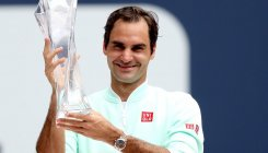 Federer defeats Isner in Miami final for 101st title