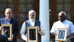 PM launches visually impaired-friendly Rs 20 coins
