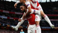 Arsenal rally to take control