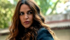 Don't believe in showmanship of a child: Neha Dhupia