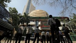 Sensex rises over 200 pts to hit record high