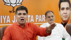 BJP for early abrogation of Articles 370, 35A: Raina