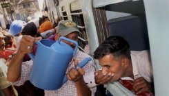 As North blazes, four die of heat in train