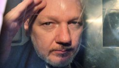 UK minister signs US bid to extradite Assange