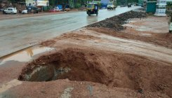 Incomplete works, rain turn road slushy