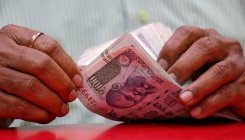 Rupee falls 18 paise to 68.84 against dollar