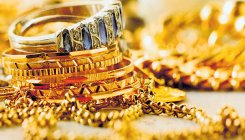 Gold plunges Rs 600 on weak global cues, muted demand