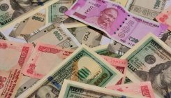Rupee spurts 25 paise to 68.33 vs USD on Fed boost