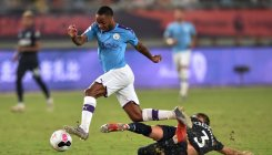 Sterling hits brace as City hammer West Ham in China