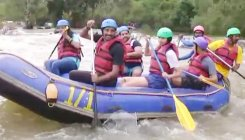 Tourists throng Dubare to enjoy rafting