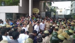 MLA hunt: Cong workers crowd outside apt complex