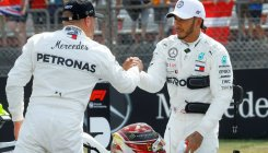 Hamilton sweeps to German pole after Ferrari falter