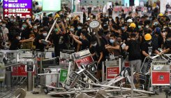 Clashes at Hong Kong airport after flights halted