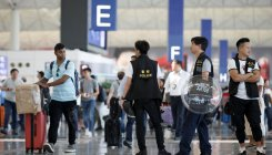 China slams HK airport protesters as 'terrorist-like'