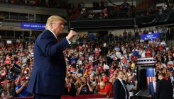 Trump defends handling of economy, China at rally