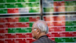 Asian investors bide time ahead of Powell speech
