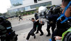 Tear gas fired as HK riot police, protesters clash