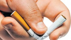 Ban tobacco use to combat cancer