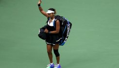 Defending champ Osaka knocked out by Bencic