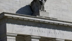 US Fed cuts key interest rate by a quarter point