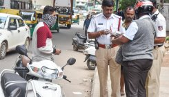 Bus driver fined in Noida for 'not wearing helmet'