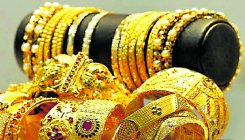 Gold drops by Rs 121 on strong rupee, weak global cues