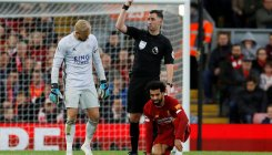 Liverpool's Salah escapes with twisted ankle