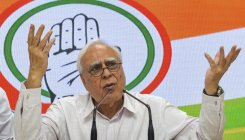 PM should attend to work, have less photo ops: Sibal