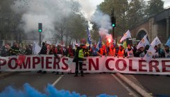 French police water cannon protesting firefighters