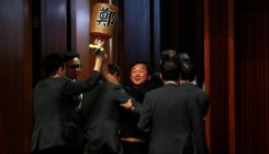 HK lawmakers dragged from chamber, leader heckled