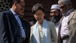 Hong Kong leader visits mosque struck by blue dye