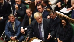 PM pauses Brexit bill after losing timetable vote