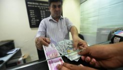 Rupee down 15 paise to 70.84 against USD in early trade