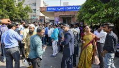 Angry lawyers gather outside district courts in Delhi
