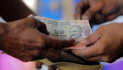 Rupee dips 14 paise to 71.11 against USD in early trade