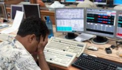 Sensex tanks 330 pts as Moody's cuts credit outlook