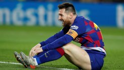 Messi's dead-ball hat-trick puts Barca back on top