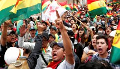 Protesters seize state-run media in Bolivia