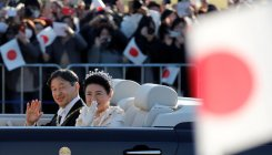 Cheering crowds greet Naruhito in rare parade