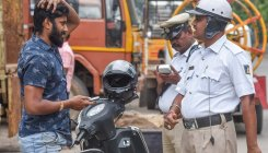 Towing boy collects traffic fine, cop in trouble