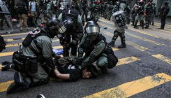 Australia urges restraint from Hong Kong police