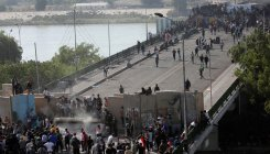 Protesters spill back onto bridge in Iraq capital