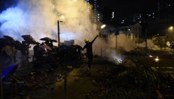 HK police warn 'live fire' if protesters use weapons