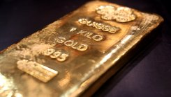 Gold slides by Rs 53, silver prices fall Rs 20